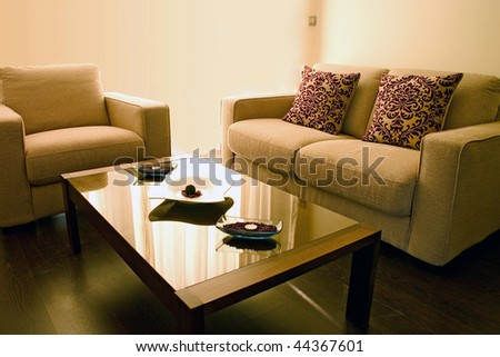 Living Room on Living Room With Cosy Sofa And Arm Chair And Small Table  Stock Photo