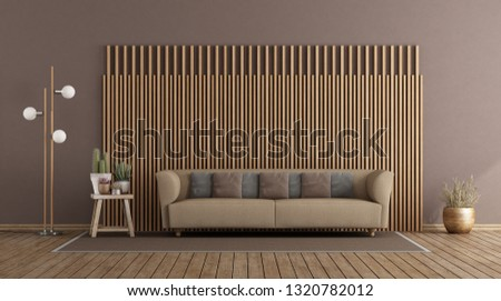Living room with elegant sofa against wooden paneling wooden paneling - 3d rendering