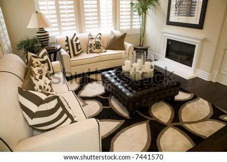 Living room with fireplace and stylish decor. - stock photo