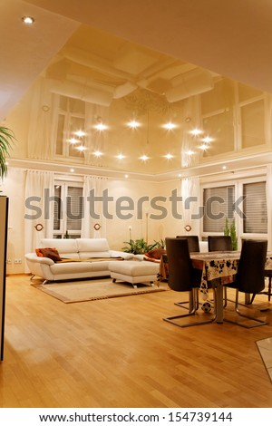 Living room with halogen lighting at the night.