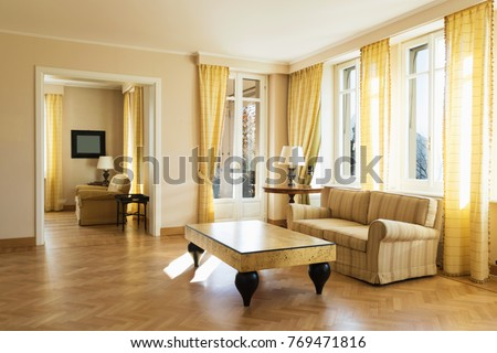 Living room with lake view and yellow sofa