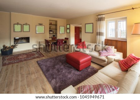Living room with leather sofa doors to the garden. Nobody inside. #1045949671