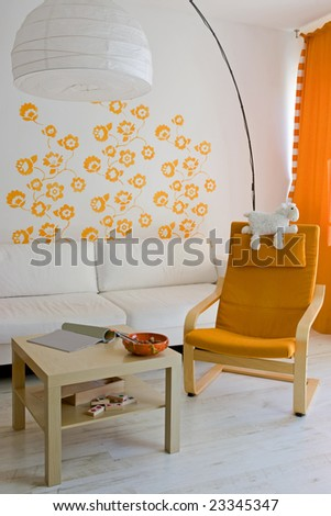 living room with orange armchair