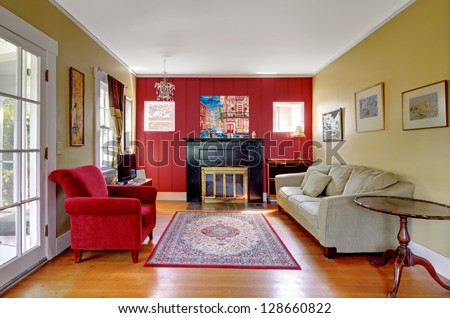 Living room with red and yellow walls and fireplace in old American house.