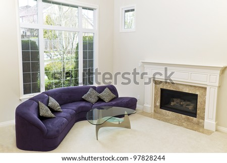 Living Room With Sofa, Glass Table, Fireplace And Carpet Floors ...
