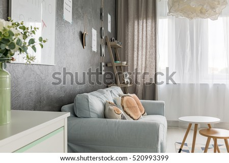 Living room with sofa, small round table and window curtains
