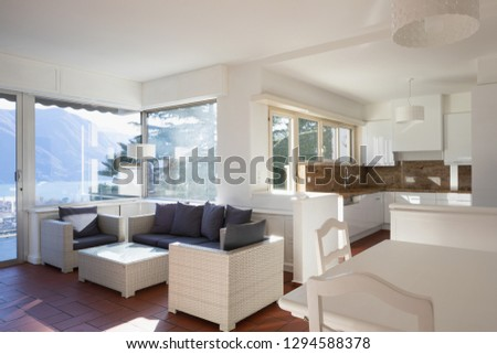 Living room with window overlooking the lake, nobody inside