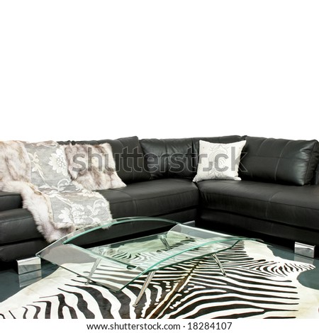 Living room with zebra hide and leather sofa