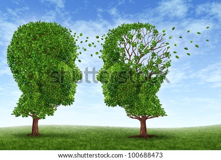 Living with alzheimers disease with two trees in the shape of a human head and brain as a symbol of the stress and effects on loved ones and caregivers by the loss of memory and intelligence. - stock photo