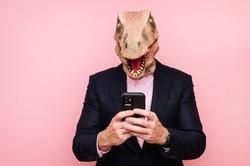 Lizard headed man using smartphone.