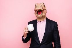 Lizard-headed man with a cup of coffee.