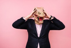 Lizard-headed man with his hands on his head.