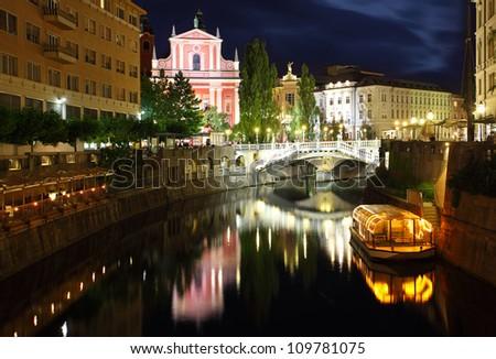 Ljubljana at night, with the Triple Bridge and Franciscan Church, Slovenia