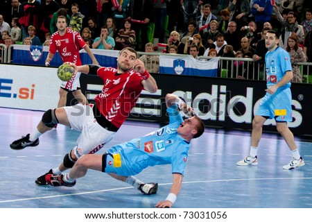 LJUBLJANA, SI - MARCH 9: Slovenian handball players (blue) play a match against Poland in qualification for handball ehf euro 2012 in Serbia on March 9, 2011 in Ljubljana, Slovenia.