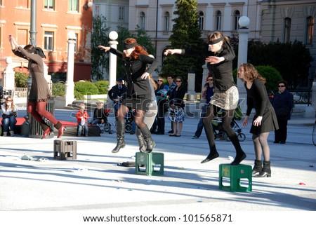 LJUBLJANA; SLOVENIA - APRIL 26: Dancers of dance groups Mana, KUD Ljud and  pupils at street dancing festival Preserna Ana for World Dance Day on April 26, 2012, in Ljubljana, SI. Jump into unknown.