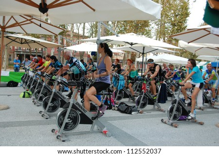 """LJUBLJANA, SLOVENIA - AUGUST 28: Spinning marathon challenge. Charity sport event organized by Society """"Project Man"""" on August 28, 2012, in open air at Kongresni square in Ljubljana, Slovenia."""