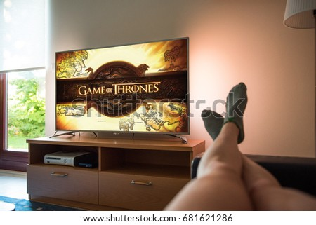 Ljubljana, Slovenia- JUN 17, 2017: Watching Game of Thrones, a famous American fantasy drama television series created for HBO, in a livingroom.