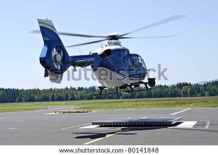 LJUBLJANA, SLOVENIA - JUNE 21: Slovenian police helicopter Eurocopter (registration S5-HPH), lands on Ljubljana Airport, after he arrives from the regular patrol, on June 26,2011. - stock photo