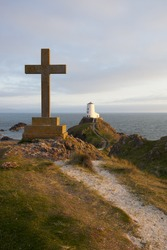 llandwyn island in north wales cross and lighthouse
