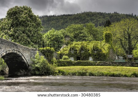 Llanrwst and the old bridge and court house now a tea room covered in ivy
