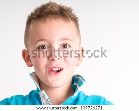 lLittle boy close up portrait - isolated on white background
