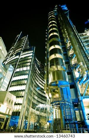 Lloys building at night, London city.