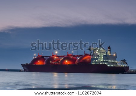 LNG TANKER - Sunrise at the gas terminal and tanker in Swinoujscie