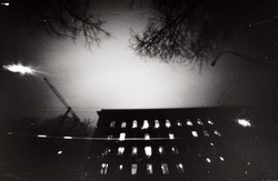 Lo-Fi film photography style night scene. Lot of grain, scratches and dust.