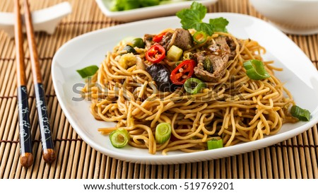 Lo mein with vegetables, mushrooms and soy filets. ストックフォト ©