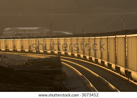 Loaded coal hoppers at twilight. - stock photo