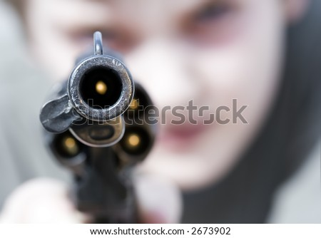Loaded gun aimed at you, focus on gun barrel (shallow dof)
