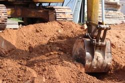 Loader backhoe,excavator digging a trench,Work of excavating machine on building construction site
