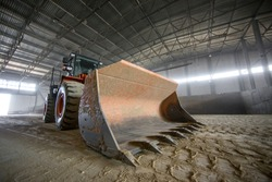 Loader in the production and extraction of raw materials. ladle wide angle