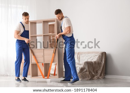 Loaders carrying furniture in flat ストックフォト ©