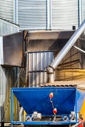 Loading a wagon with grain crops in elevator in agriculture zone. Grain silo, warehouse or depository is an important part of harvesting.
