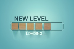 Loading bar progress concept. Next Level text loading almost complete with wooden blocks in progress bar.
