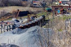 Loading breakstone into freight train in a granite quarry