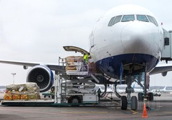 Loading cargo into the aircraft before departure