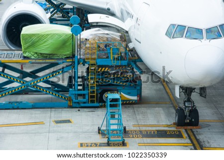 Loading cargo on the plane in airport, view through window,Loading platform of air freight to the aircraft