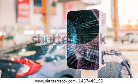 Loading energy of an electric car, Power Supply charging on charge station electromobility environment-friendly, plugged into an electric automobile being charged. Stock photo ©