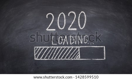 Loading for new 2020 year on chalk board, panorama, copy space #1428599510