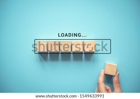 Loading, hand putting wood cube in progress bar. Сток-фото ©