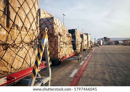 Loading of cargo containers to airplane at airport.  Photo stock ©