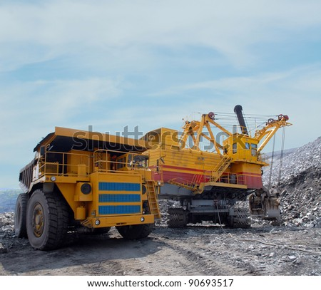 Loading of iron ore on very big dump-body truck