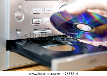 Loading or putting CD medium into player