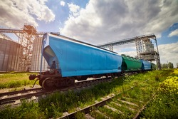 Loading railway wagon standing near the elevator in agriculture zone. Grain silo, warehouse or depository is an important part of harvesting