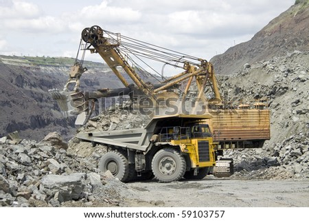 Loading the iron ore into heavy dump truck at the opencast mining