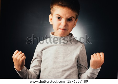 Loads of aggression in a little boy - education concept hinting behavioral problems in young children