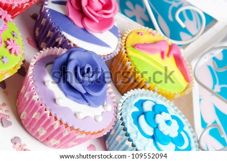 loads of colorful cupcakes for birthday or wedding party