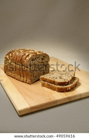 Loaf of bread on cutting board - stock photo